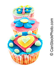 three cupcakes with marzipan decoration