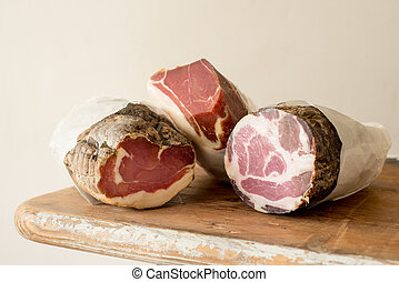 Three Cured Meat Logs on Counter - Three deli meat or lunch...