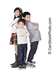 Three cute children posed over white background
