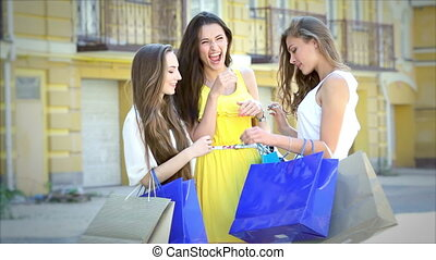 Three cute girls meet while shopping, and consider buying...
