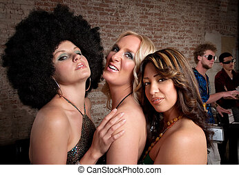 1970s Disco Music Party - Three cute ladies posing at a...