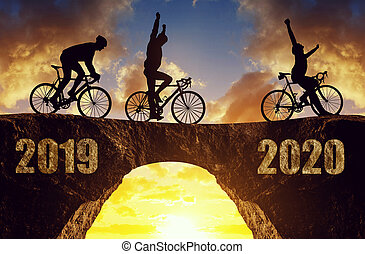 Forward to the New Year 2020. - Three cyclists ride a road ...