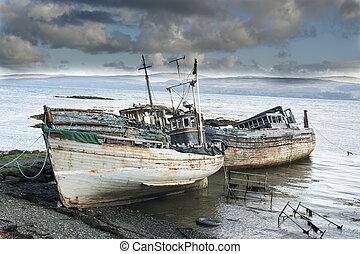 Three derelict fishing trawlers