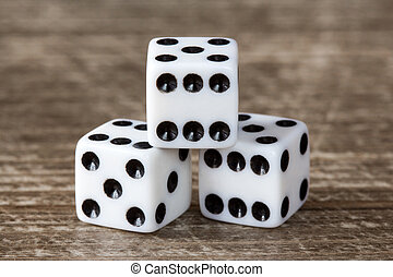 Three dice on wooden table