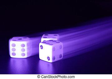 Three dice with motion blur
