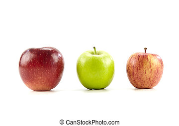 three different apples on white background