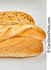 Three different baguettes on white background.