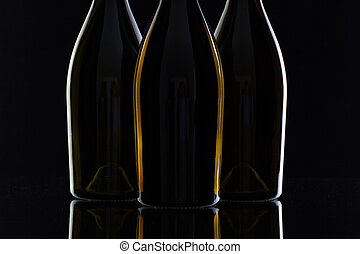 Three different bottles of wine