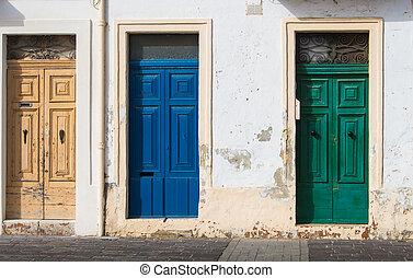 Three different color doors