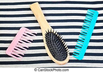 Three different comb on striped fabric