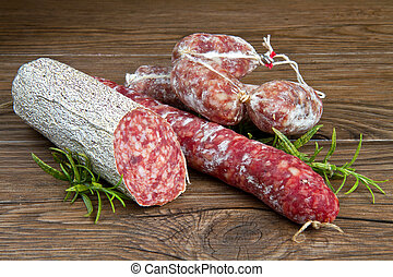 salami - three different kind of salami on wooden table