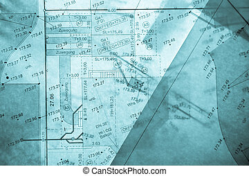 different layers of blue backlit surveyor\'s plans - three...
