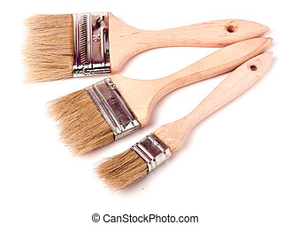 Three different size paint brushes isolated on white background