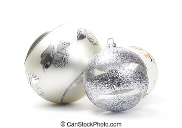 three different white and silver christmas balls on white background