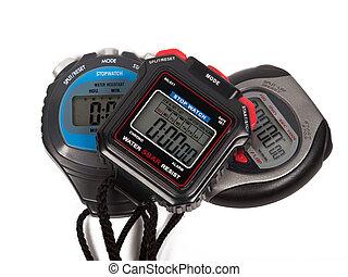 Three digital stop watches
