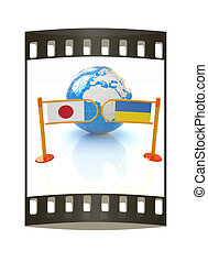 Three-dimensional image of the turnstile and flags of Japan and Ukraine. The film strip
