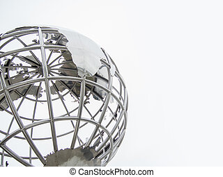 three-dimensional metal globe sculpture on the street, conceptual image of planet earth