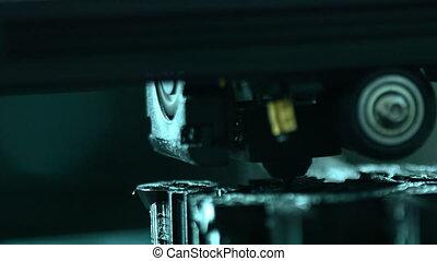 Three dimensional plastic printer during work