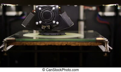Three dimensional printer during work in laboratory, 3D plastic printer, 3D printing