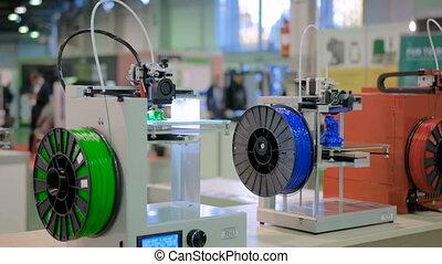 Three dimensional printing machine prints physical 3D model...