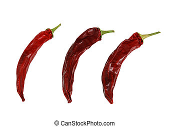 Three dried hot red chili peppers isolated on white