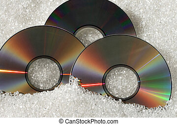 Three DVDs - Three DVD disks with plastic granulate material