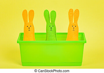 Three easter Bunnies in flower pot