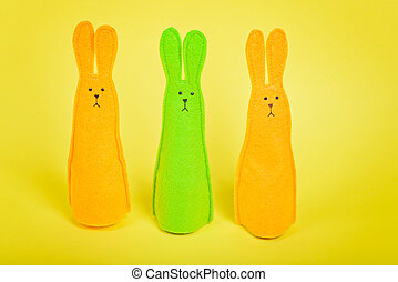 Three easter Bunnies on yellow