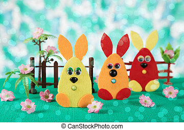 Three Easter bunny. - Three Easter bunny toy in the form of...