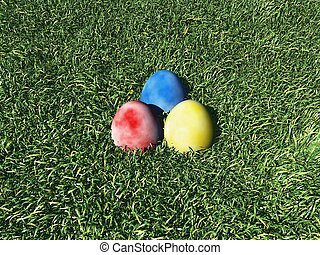 Three Easter Eggs on the grass
