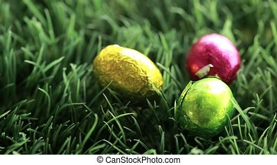 Three easter eggs packed in aluminium red yellow and green