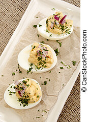 egg halves with a mustard mayonnaise filling