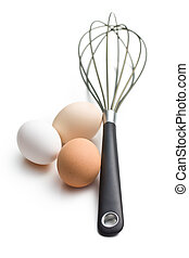 three eggs and whisk