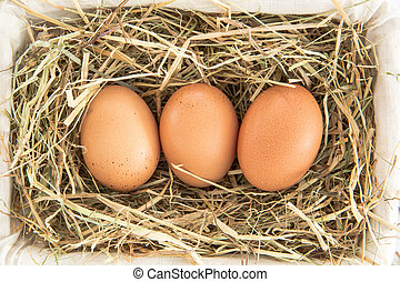 Three eggs in a basket