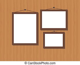 Three empty brown frames on wooden wall.