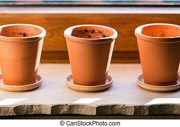 three empty flower pots
