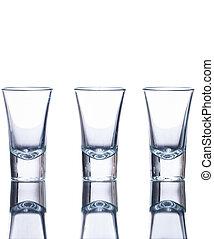 Three empty shot glasses