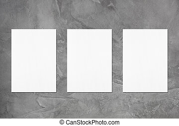 Three empty white vertical rectangle poster mockups with ...