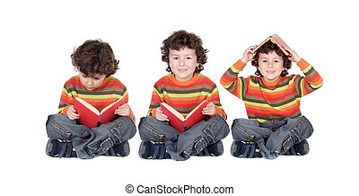 Three equal children reading a red book seated