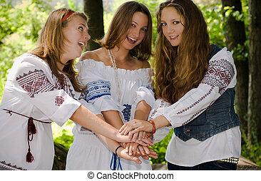 Three Ethno Beauty teens having fun