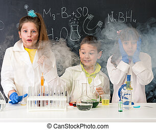 three excited children after chemical experiment