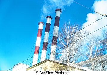 Three factory pipes smoke