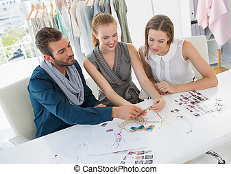 Three fashion designers discussing