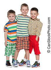 Three fashion little boys in striped shirt