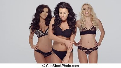 Three fashion models in black lingerie
