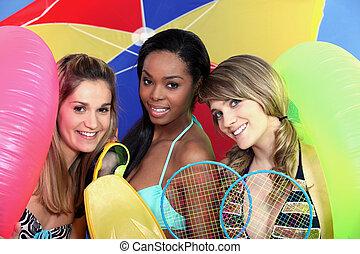 Three female friends at the beach