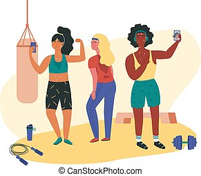Three females doing sweaty selfie check-ins during gym session. Asian, black and white girls working out at fitness class with jump rope, dumbell, punching bag, platform. Functional training.