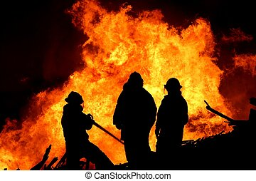Three fire fighters and flames - Three firemen fighting a...