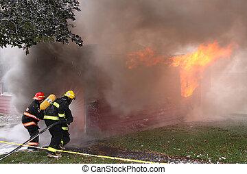 Three Firemen during an intense training