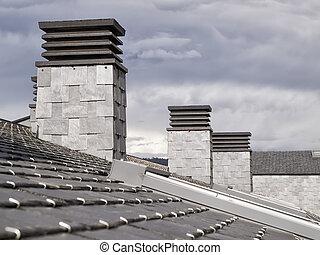 Three fireplaces on a slate roof